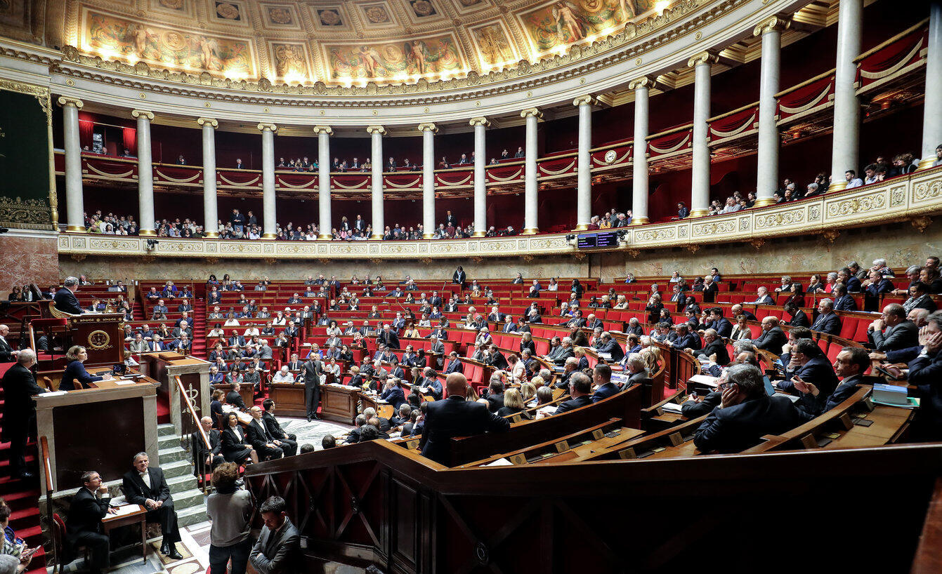 Lawmakers in France's lower house of parliament, the National Assembly, hear Prime Minister Edouard Philippe's defence of the use of constitutional powers to force through a contested pension reform, 3 March 2020.