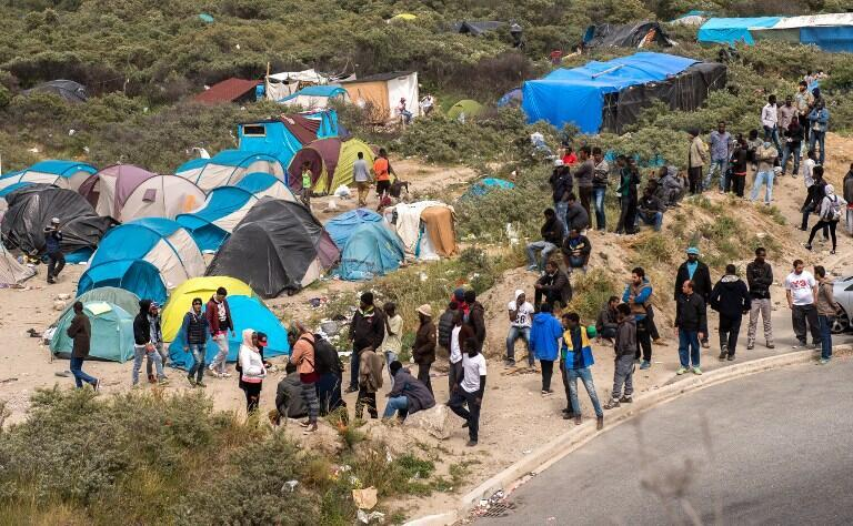 """Calais migrants live on a former rubbish tip known as """"the new jungle"""""""