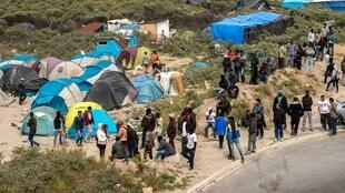 "Thousands of migrants in the French city of Calais have relocated to a shantytown known as the ""New Jungle"", where they wait in hopes of reaching the United Kingdom."