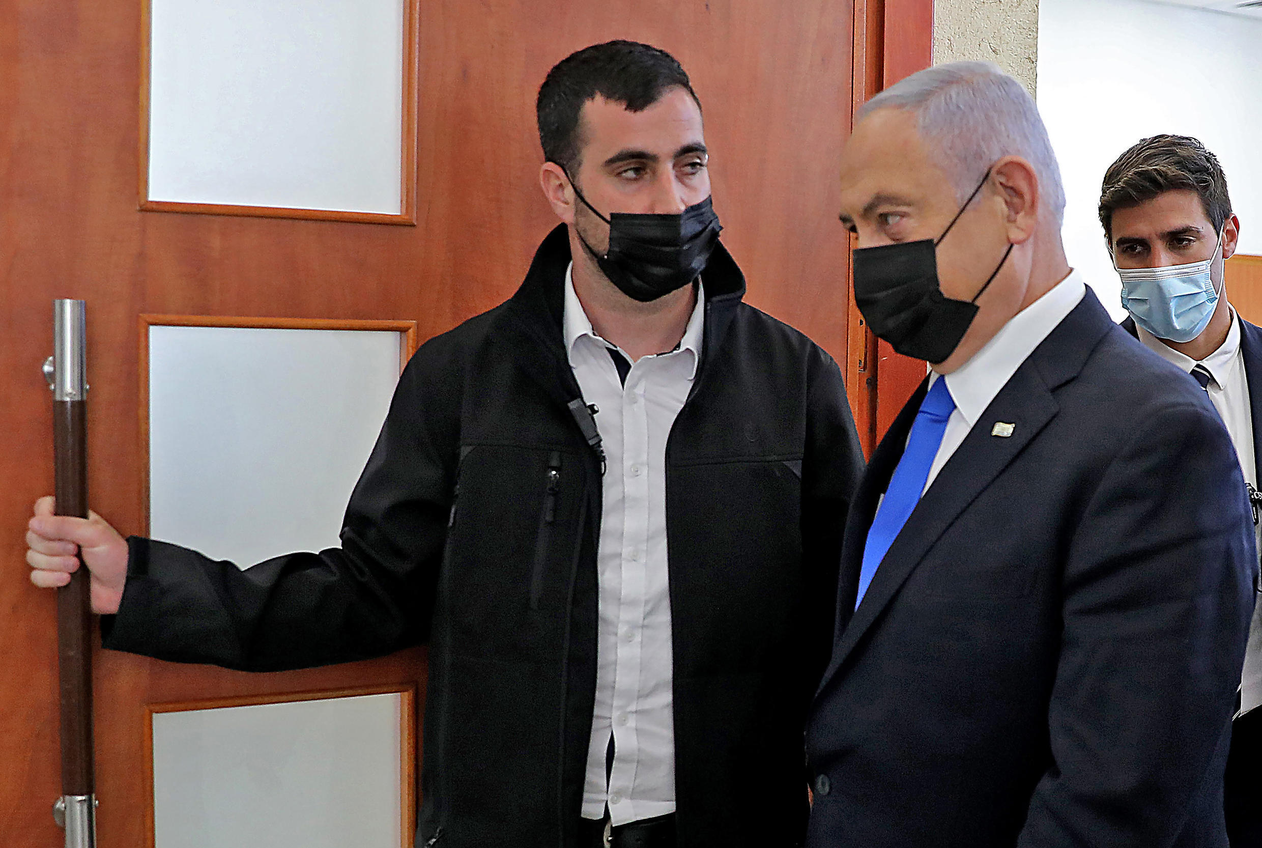Israeli Prime Minister Benjamin Netanyahu, who is seen here leaving court last month after a hearing in his corruption tiral, faces a midnight deadline to form a government after an inconclusive March election