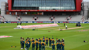Pakistan players huddle on the pitch ahead of play on the first day of the first Test against England at Old Trafford