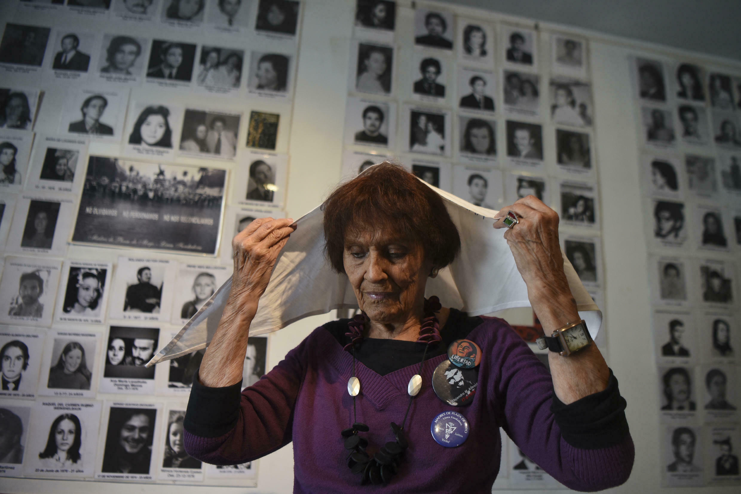 Taty Almeida, one of the Madres de Plaza de Mayo, in front of pictures of people who disappeared under the dictatorship in Buenos Aires