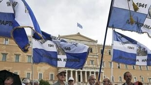 Manifestação em frente ao Parlamento grego contra a proposta de novas medidas de austeridade para o país sair da crise.