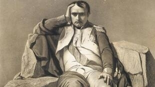 A lithograph of Napoleon in exile on St Helena, based on an oil study by Paul Delaroche (produced in 1859, 38 years after Napoleon's death)