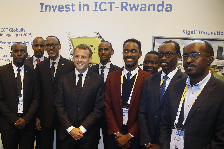 Rwanda's President Paul Kagame and France's President Emmanuel Macron pose with Rwanda tech entrepreneurs at VivaTech on 24 May 2018.