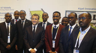 Rwanda's President Paul Kagame and France's President Emmanuel Macron pose with Rwanda tech entrepreneurs at VivaTech on 24 May 2018.