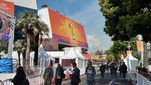 The Cannes Festival Palace early morning, film fans desperately seeking invitations for Golden Palm Competition premières, May 2019