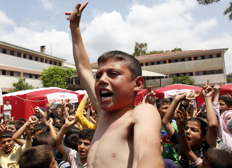A Syrian boy joins an anti-Assad demonstration in Turkey