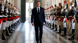 Emmanuel Macron approaches his audience at Versailles