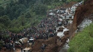 The scene of a mudslide that buried a bus in Guatemala last year