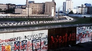 A view of the Wall which separated communist-controlled East Germany from West Germany. Graffiti marks the West Berlin side while the East side remains spotless.