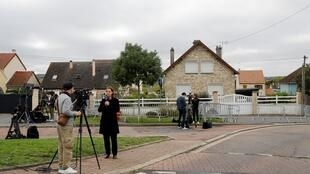 Journalists outside the house in Limay, west of Paris, searched by police in connection to an arrest of a man in Scotland who was thought to have been fugitive murder suspect Xavier Dupont De Ligonnes, 12 October 2019
