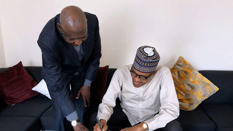 President Muhammadu Buhari signs Deep Offshore bill into law in London, with Chief of Staff Abba Kyari
