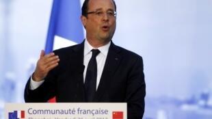 Hollande discursa durante um encontro na residência geral do consulado francês em Shangai