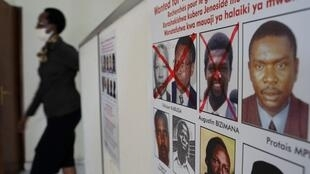 A poster showing faces of Rwandan genocide suspects in the capital, Kigali. Félicien Kabuga was crossed off following his arrest in France in May 2020.