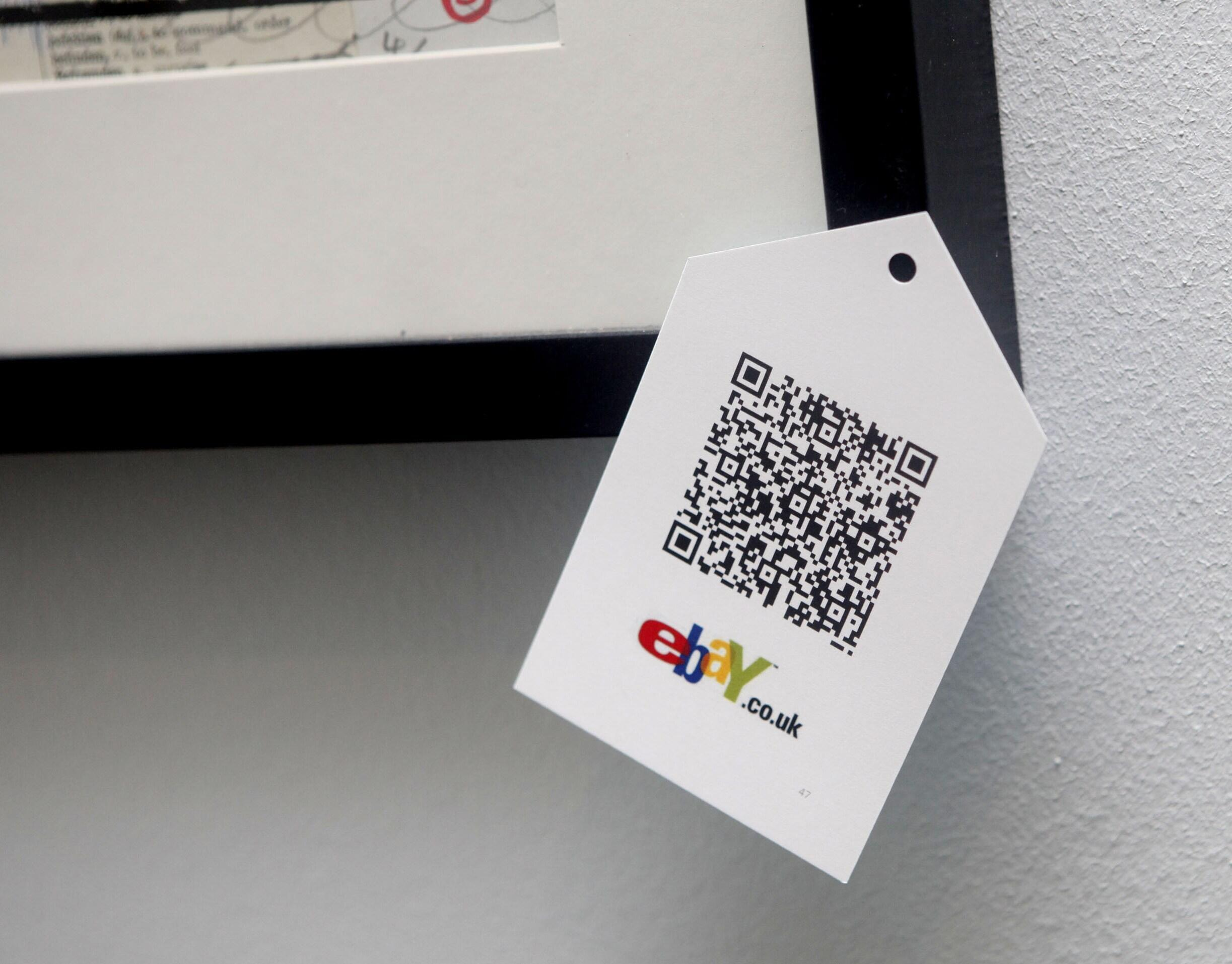 """A QR code is seen on goods for sale during the launch of the temporary """"pop-up"""" Christmas shop"""