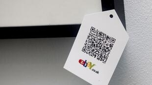 "A QR code is seen on goods for sale during the launch of the temporary ""pop-up"" Christmas shop"