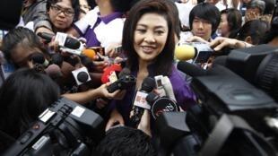 Yingluck Shinawatra faces the press on Sunday
