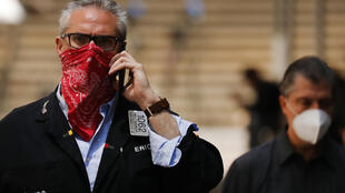 A trader last year shown in front of the New York Stock Exchange, which plans to ease more of its Covid-19 restrictions