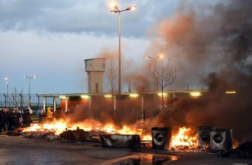 Strikers picket the prison at Vendin-le-Vieil on Tuesday