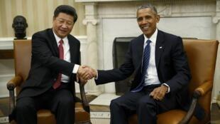Les deux présidents chinois et américain dans le bureau ovale de la Maison Blanche à Washington, le 25 septembre 2015.