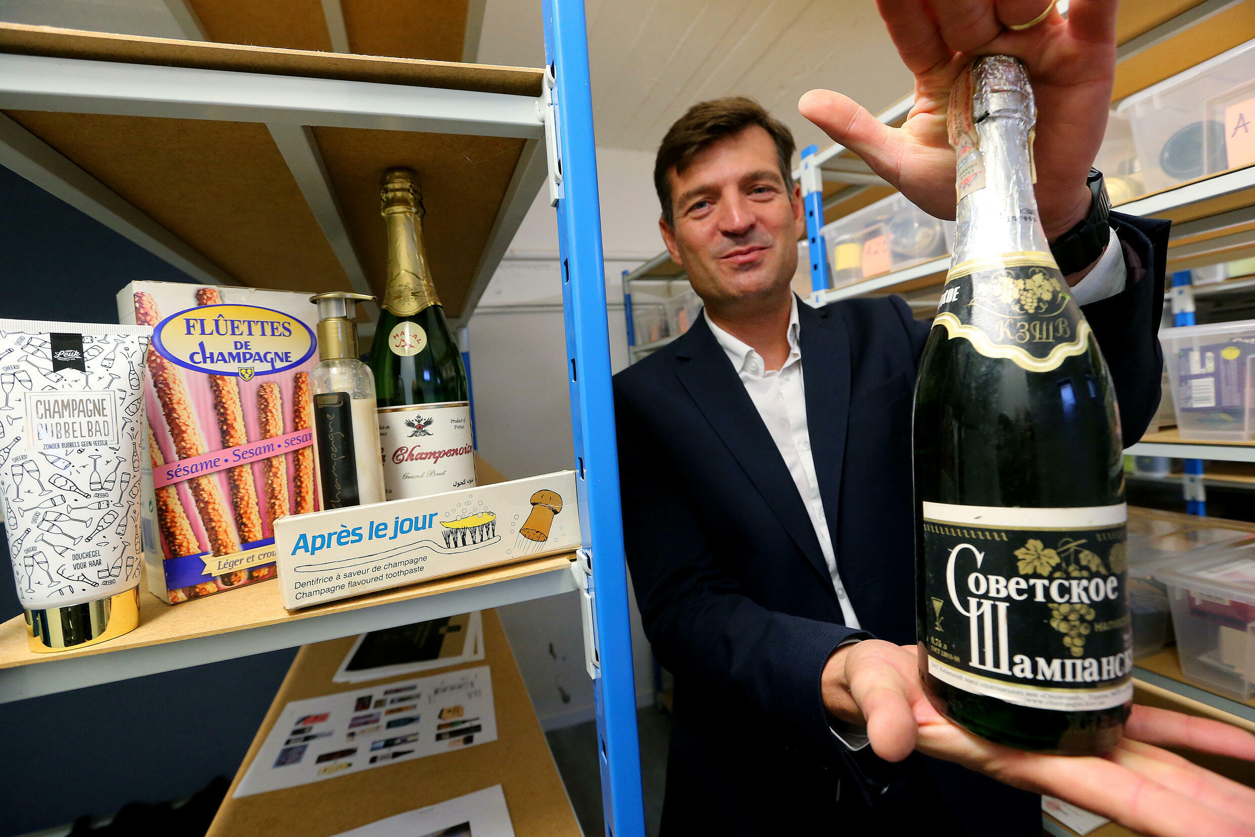 CIVC boss Charles Goemaere shows Russian sparkling wine which has hijacked the champagne name