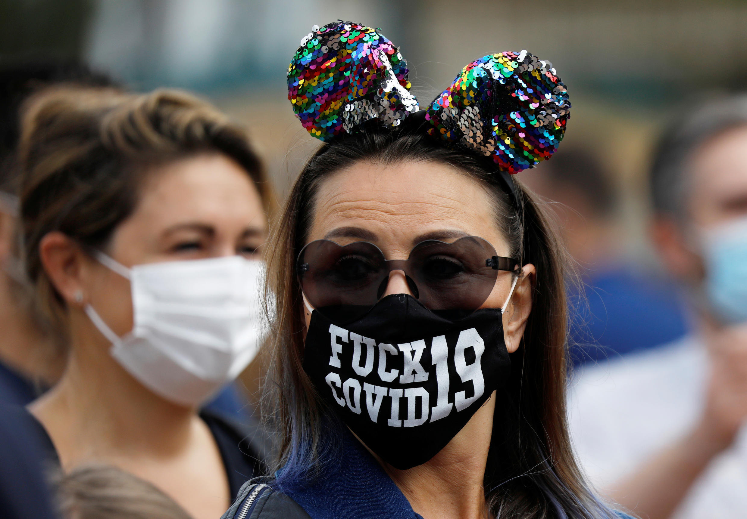Visitors wear protective face masks at Disneyland Paris as the theme park reopens its doors to the public in Marne-la-Vallee, near Paris, following the coronavirus disease (COVID-19) outbreak in France, July 15, 2020.
