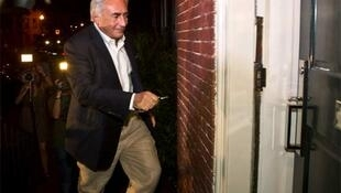 Former Managing Director of the International Monetary Fund (IMF) Dominique Strauss-Kahn arrives at his Georgetown home in Washington,