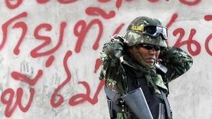 A Thai soldier at a barricade previously occupied by Red Shirt protesters