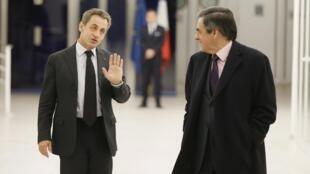 Nicolas Sarkozy com O ex-primeiro-ministro François Fillon.