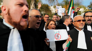 Lawyers hold banners as they chant slogans during a protest to denounce an offer by President Abdelaziz Bouteflika if re-elected, Algiers, March 7, 2019.