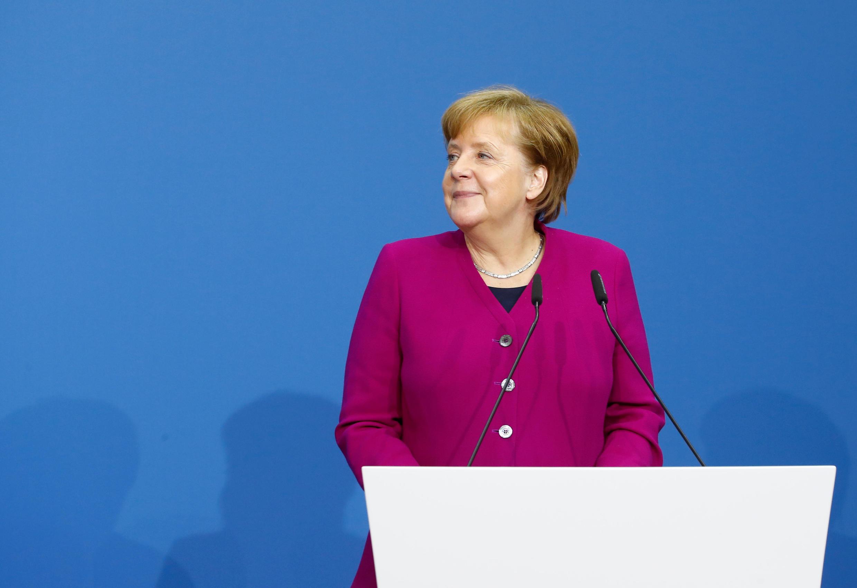 La chancelière allemande Angela Merkel lors de son discours avant la signature du contrat de coalition, sociaux-démocrates et conservateurs, à Berlin, le 12 mars 2018.