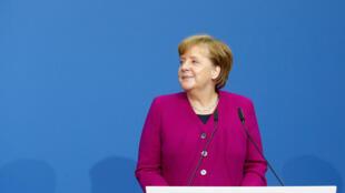 La chancelière allemande Angela Merkel avant la signature du contrat de coalition, sociaux-démocrates et conservateurs, à Berlin, le 12 mars 2018.