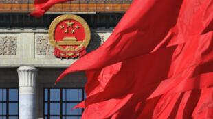 Cờ Trung Quốc trước Đại Sảnh Đường Nhân Dân Trung Quốc nhân lễ bế mạc khóa họp Chính Hiệp Trung Quốc tại Bắc Kinh (Trung Quốc) ngày 13/03/2019. Ảnh minh họa.3, 2019.