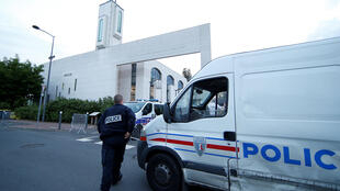 Police in front of a mosque in Créteil, near Paris, after a man drove a car towards it earlier this year