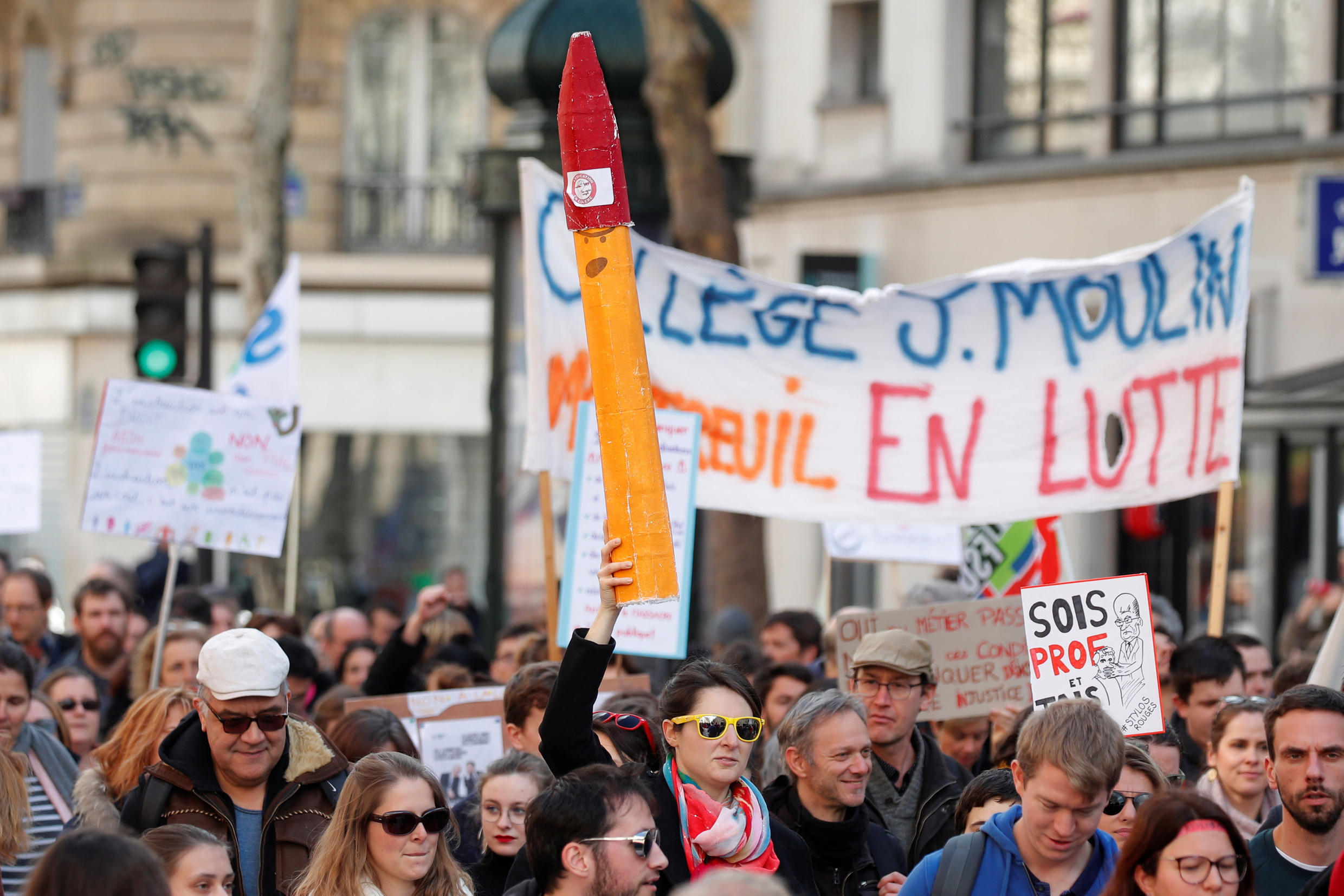 """French school teachers, from the """"Stylos Rouges"""" (Red Pens) mouvement, demonstrate against French Education minister Blanquer's law as part of a protest against the French government's reforms in Paris, March 19, 2019."""