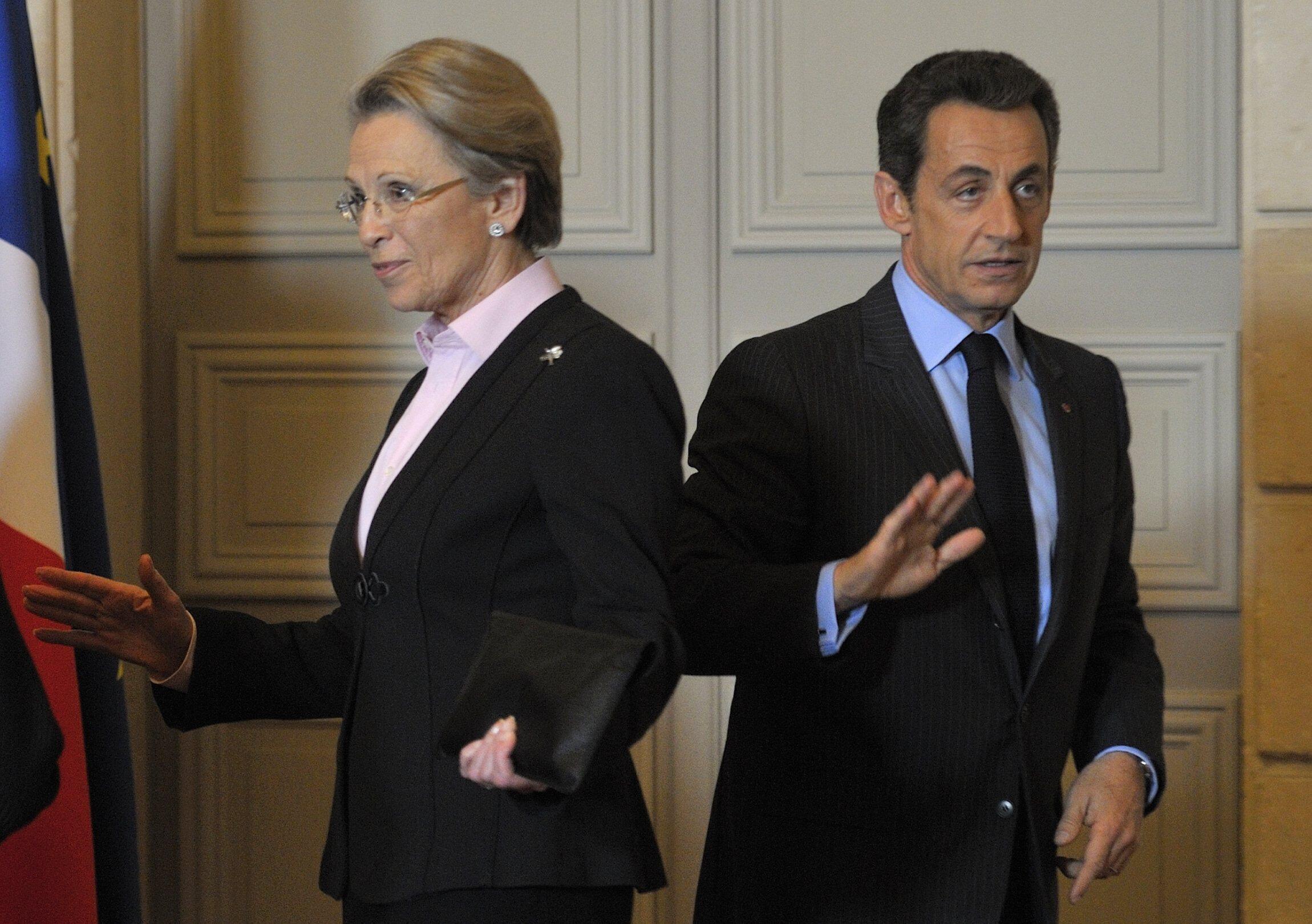 Soon to part company? President Nicolas Sarkozy with Michèle Alliot-Marie