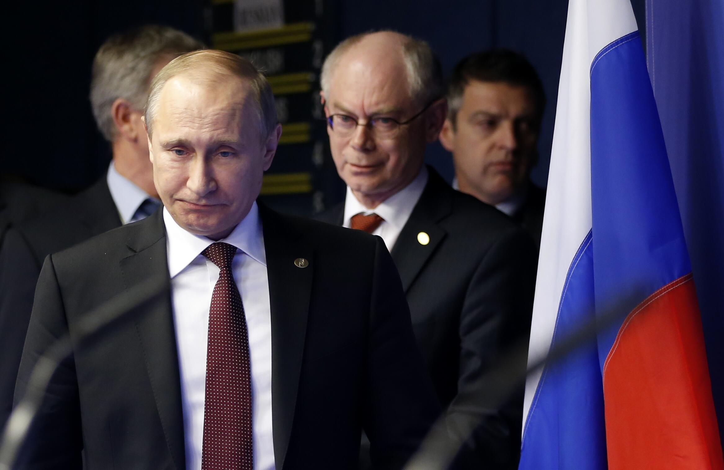 Le président russe Vladimir Poutine (g.) et le président du Conseil européen Herman Van Rompuy, à Bruxelles, le 28 janvier 2014.