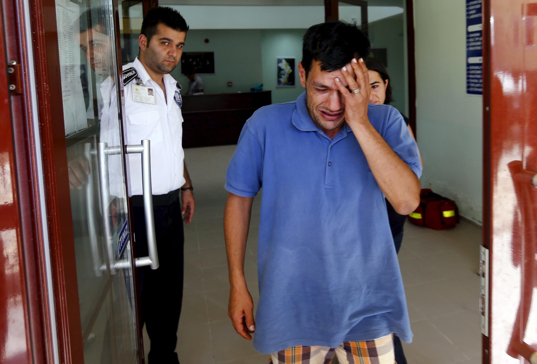 Abdullah Kurdi, father of three-year old Aylan Kurdi, cries after viewing his son's body in Mugla, Turkey