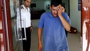 Abdullah Kurdi, father of three-year old Aylan Kurdi, cries after viewing his son's body in Mugla, Turkey