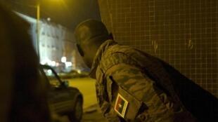 A Burkinabè soldier looks at the besieged Hotel Splendid
