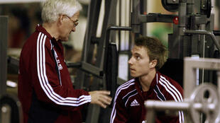 Denmark's national team soccer coach Morten Olsen speaks with Christian Eriksen at a gym in Krugersdorp