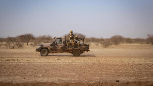 Soldiers on the road to the northern town of Dori -- Burkina Faso holds an election on Sunday but large areas remain outside the state's control