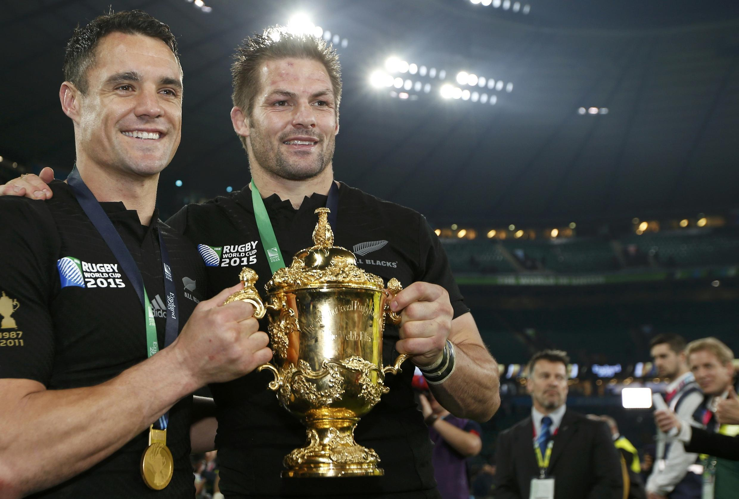 Dan Carter (left) kicked 19 points for New Zealand as Richie McCaw (right) became the first man to skipper a side to successive World Cup triumphs.
