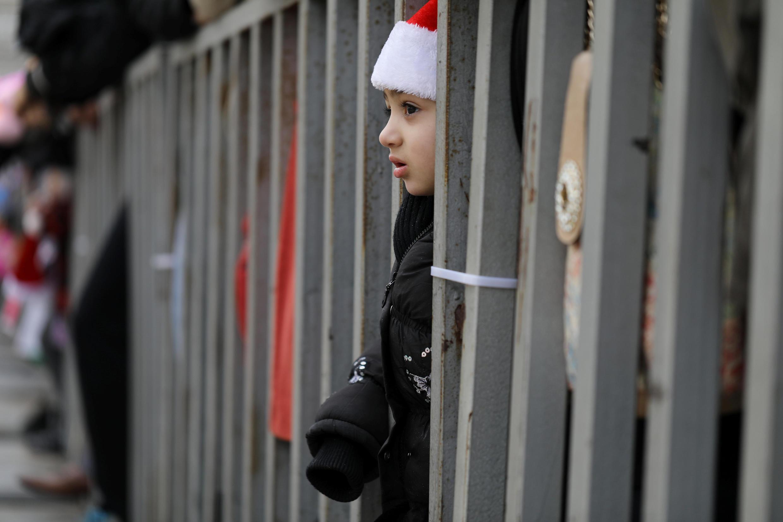 Một gương mặt buồn bã tại Bêlem chờ đón Giáng Sinh. Ảnh ngày 24/12/2017.