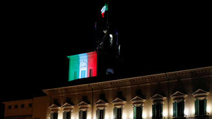 The Quirinale Presidential Palace is lit up with the colours of the Italian flag as Italy continues to battle the coronavirus disease (COVID-19), in Rome, Italy, March 30, 2020.