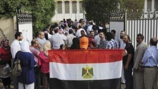 Les expatriés egyptiens, ici à Koweït, se sont rendus dans les bureaux de vote dès la semaine dernière.