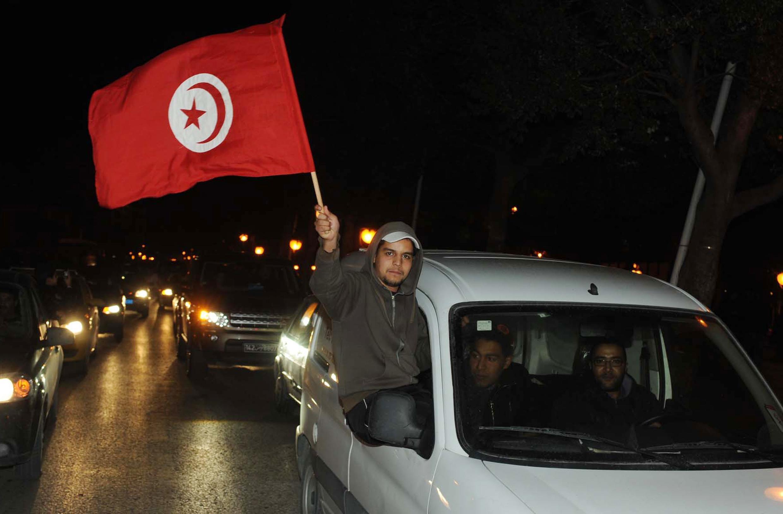 Dans les rues de Tunis, après le départ de Ben Ali, le 14 janvier 2011