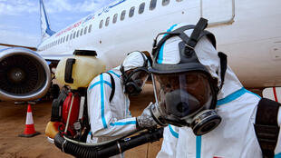 Airport staff prepare to disinfect a plane after it landed at Juba International Airport in Juba, South Sudan on 3 April 2020.