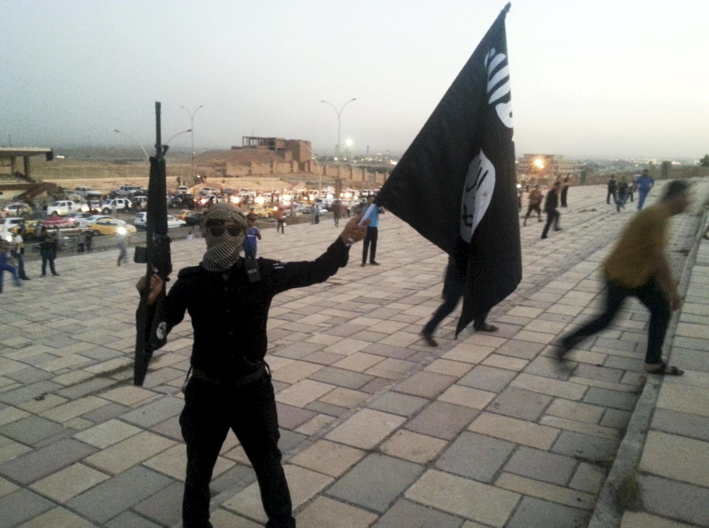 Một chiến binh của IS tại Mosul, Irak ngày 23/06/2014.